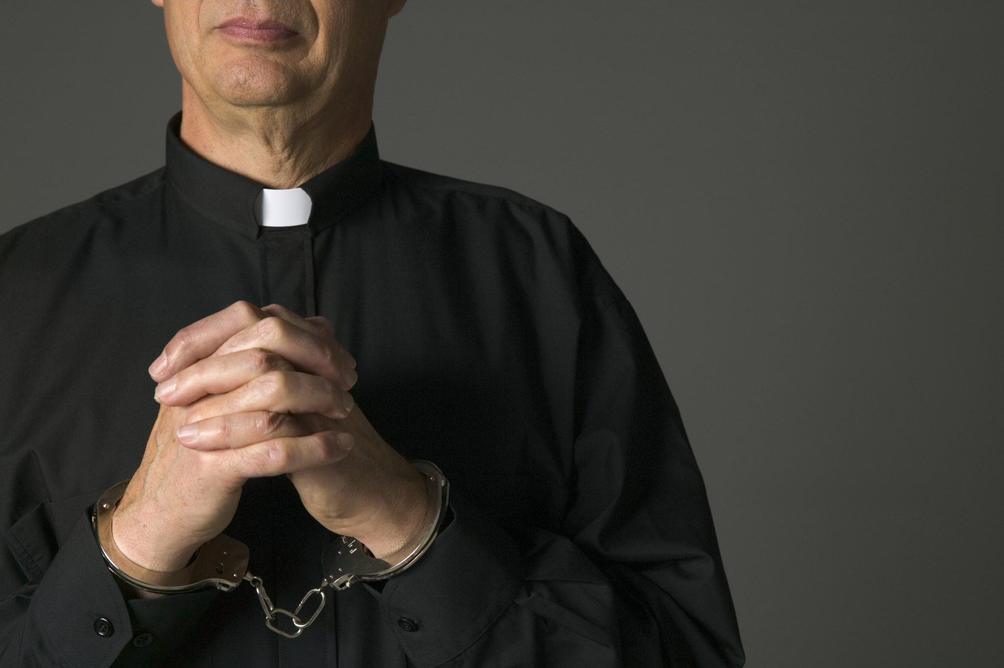 A priest in handcuffs