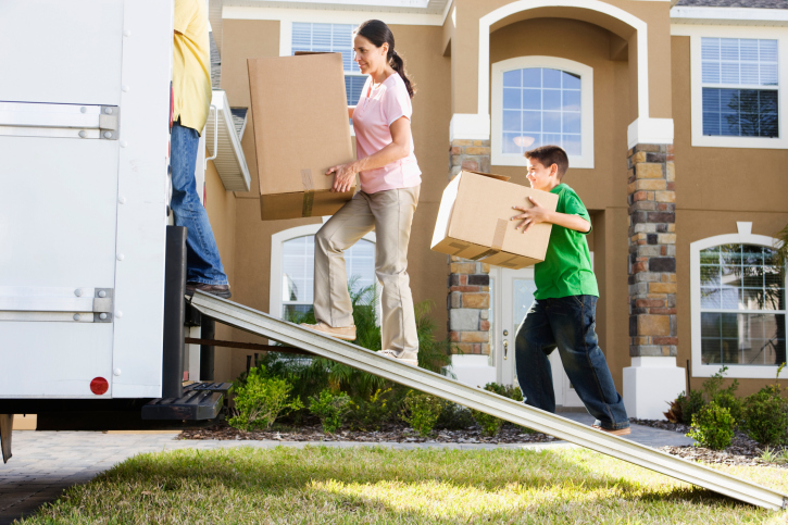 A family packs the moving truck